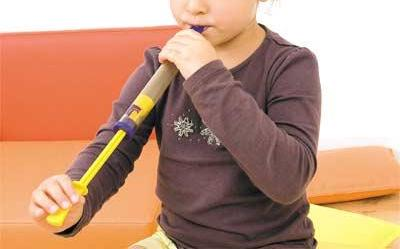 Child playing the slide flute